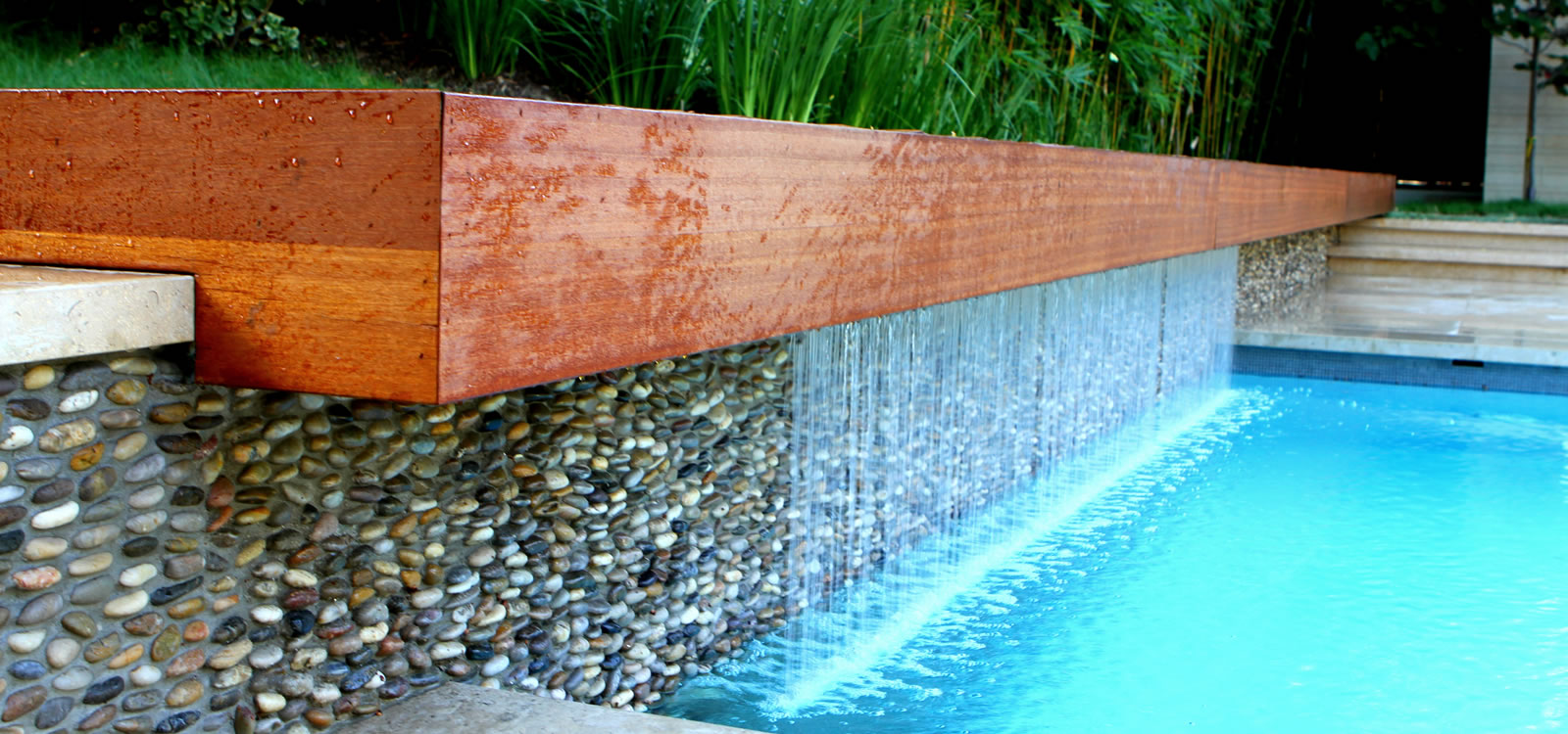 Beverly hills pool spa design with custom water feature for Custom pool designs