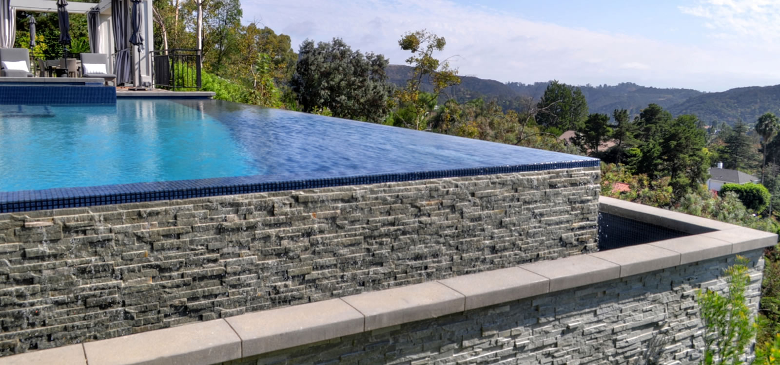 Beverly hills vanishing edge pool design with custom tile for Pool design los angeles